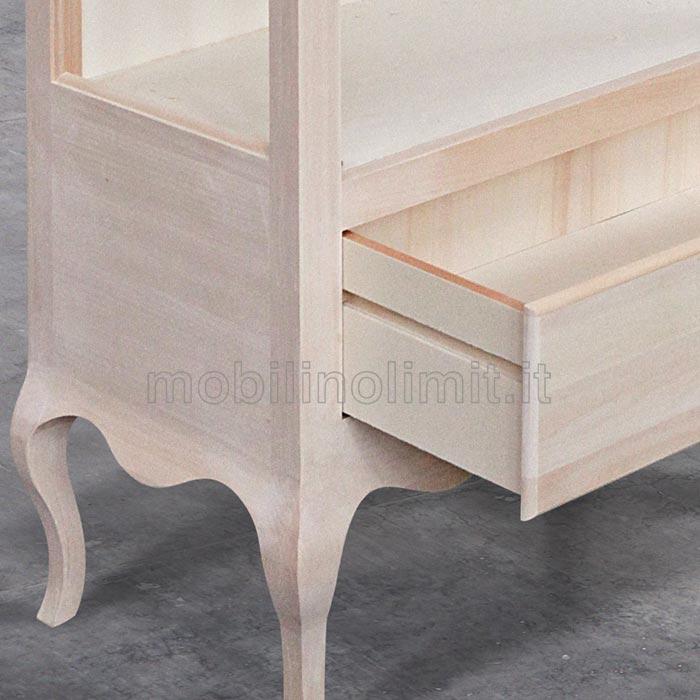 dettaglio piedini e guida cassetto in legno